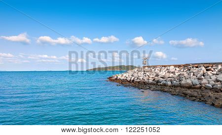 The rock pier in the calmness sea at Khao leam ya National park Rayong Province Eastern Thailand