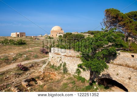 View of the Fortezza citadel, Rethymno, Crete, Greece, with Mosque of Sultan Ibrahim in background