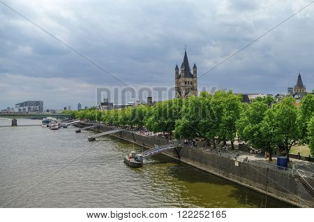 Cologne, Germany - July 10, 2011: Great St. Martin Church and River Rhine embankment Cologne Germany