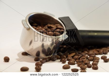 A lot of coffee beans with item of coffee-machine