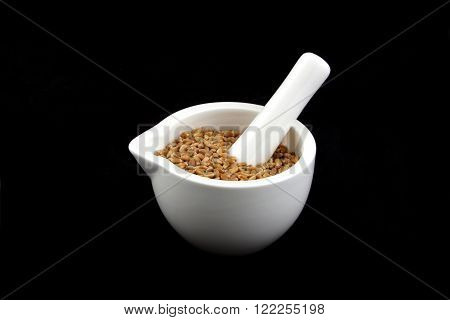 a white mortar with a cereal seeds