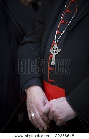 NEW YORK - MARCH 17, 2016: Close up of the hands and silver cross of Timothy Cardinal Dolan Archbishop of New York in front of St Patricks Cathedral on Saint Patricks Day, Manhattan on March 17, 2016.