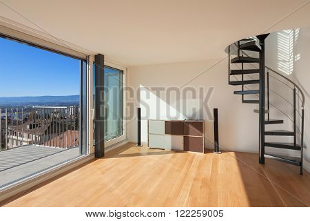 Interior, wide open space of a duplex, large window