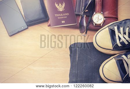 Outfit of traveler, Different objects on wooden background, Vintage style