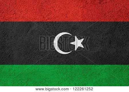 flag of Libya or Libyan banner on rough pattern background