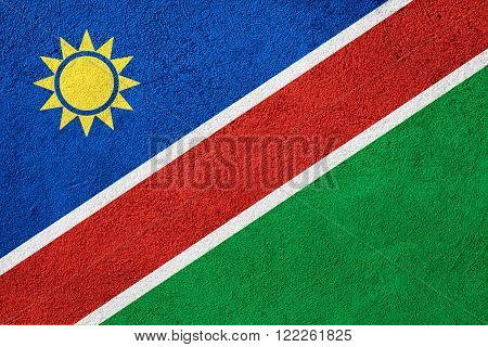 flag of Namibia or Namibian banner on rough pattern background