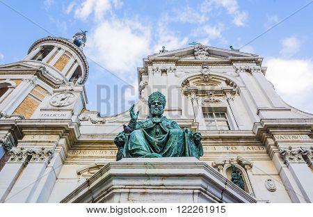 The Basilica della Santa Casa and the big bronze statue of Sixtus V in Loreto Italy.