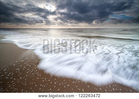 North sea waves on sand beach Zandvoort Netherlands