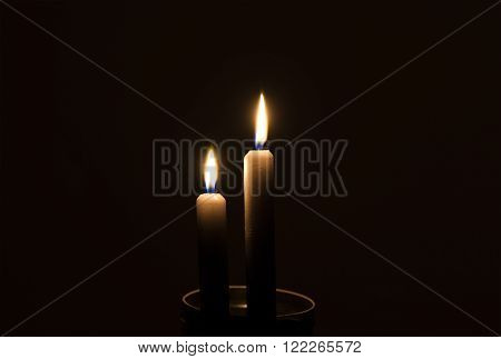 Two candles in the dark with christmas or a power outage