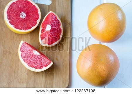fresh grapefruit on white boards food wooden background orange citrus frui place for text