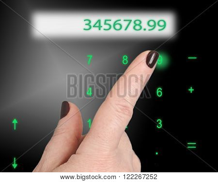 Female finger presses the greenish numbers on the keyboard. Just above the display with numbers.