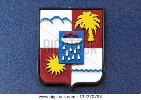 SOCHI RUSSIA - November 05 2015: A municipal coat of arms of Sochi on a blue background of a wall. Sochi Russia