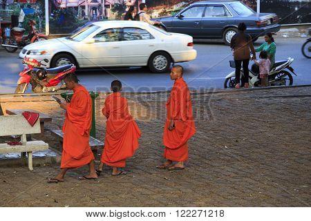 Cambodian Monks Walking On The Street In Kampot