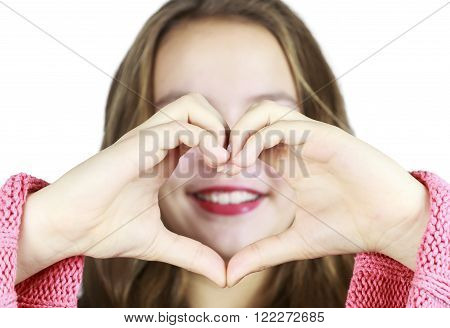 Pretty Young Girl Making a heart with Hands