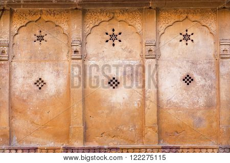 Six-pointed star and the other symbols on the ancient wall of the estate in Rajasthan India