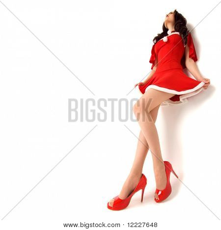 stylish woman in red xmas sexy costume isolated over white background