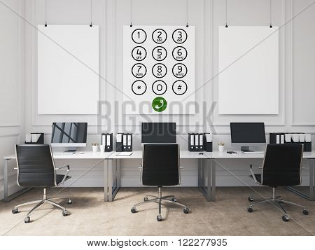 Open space office computer tables. Phone number buttons on white poster over tables. Concept of phone service.