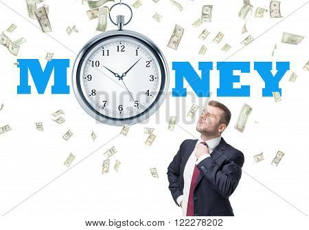 Businessman holding his tie pocket watch over him dollars falling down. White background. Concept of time is money.