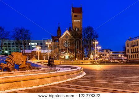 Minsk Belarus - March 5: the Church of St Simon and Helen (Red Church) and an independence square - the main square of Minsk and the city centre, night view, in March 5, 2016, in Minsk, Belarus.