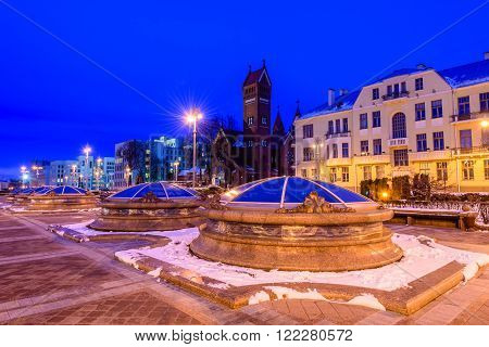 Minsk, Belarus - March 5: the Church of St Simon and Helen (Red Church) and an independence square - the main square of Minsk and the city centre, night view, in March 5, 2016, in Minsk, Belarus.