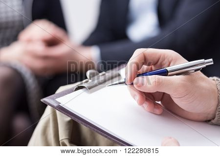 Close-up of psychotherapist's notes about young patients