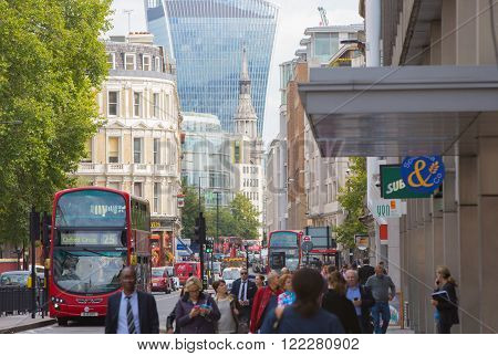 LONDON, UK - SEPTEMBER 19, 2015: Holborn street with traffic and people crossing the road