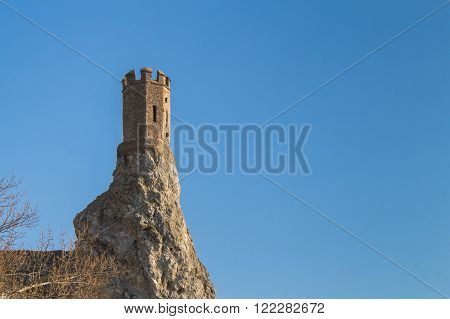 Rocks where was former fortress with a Maiden Tower part of ruins of castle Devin in Slovakia. Bright blue sky.
