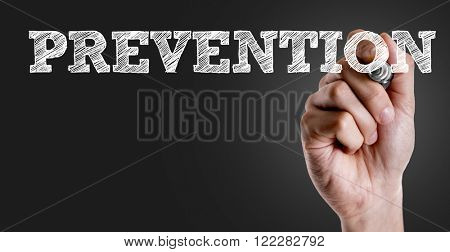 Hand writing the text: Prevention