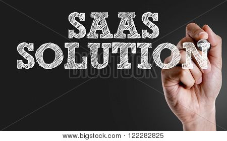 Hand writing the text: Saas Solution