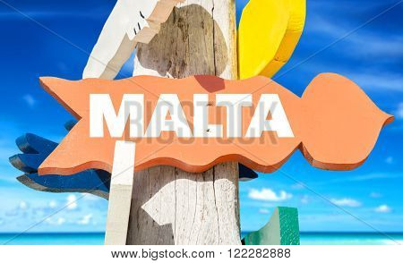 Malta signpost with beach background