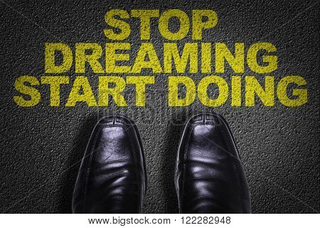 Top View of Business Shoes on the floor with the text: Stop Dreaming Start Doing