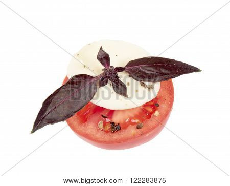 Mozzarella with tomato and basil leaves isolated on white background