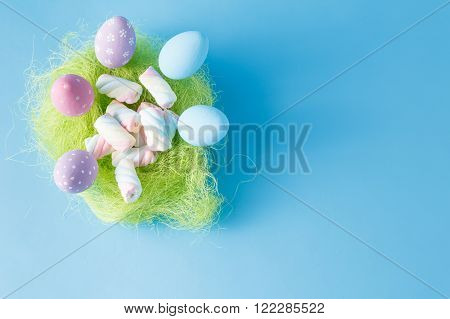Kid party decoration with easter eggs on blue background
