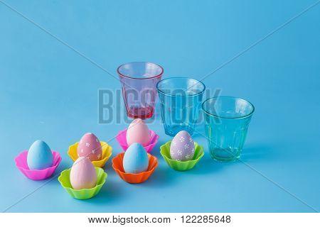 Easter eggs sty on plain blue background