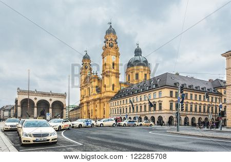 MUNICH, GERMANY - March 12, 2012: Theatine Church of St. Cajetan (Theatinerkirche). The church was built in 1663-1690 in Italian high-Baroque style with facade in Rococo style completed in 1768.
