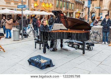 Germany, Munich - MAR 12 : Pianist at Marienplatz on March 12, 2012 in Munich, Germany.