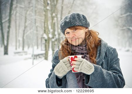 Woman With Cup Outdoors