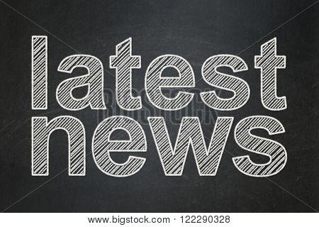 News concept: Latest News on chalkboard background