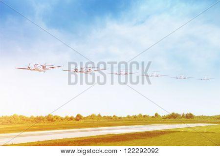 Passenger airplane landing on runway in airport. Multiple plane track