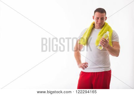 Man bodybuilder posing on a white background Man holding a bottle of water. Man, water,. Sport,