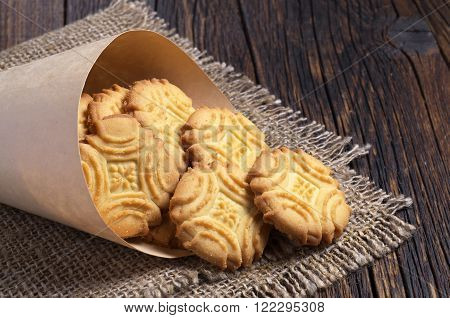 Biscuit shortbread cookies homemade in paper bag on the table