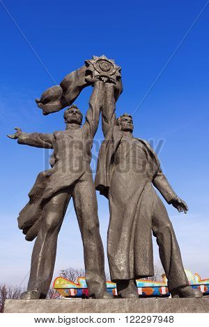 Kiev, Ukraine - MARCH 8, 2016: Monument depicting workers symbolizing the friendship between the Russian and Ukrainian peoples erected in 1982