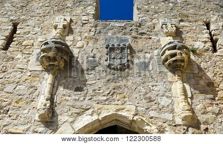 Details of the armillary spheres with the Christ Cross on top and the coat of arms at the portal of the Castle of Torres Vedras Portugal