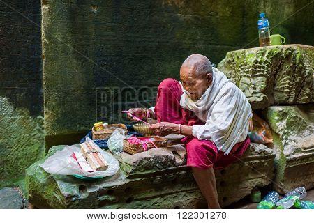 Elderly Nun At Ancient Temple