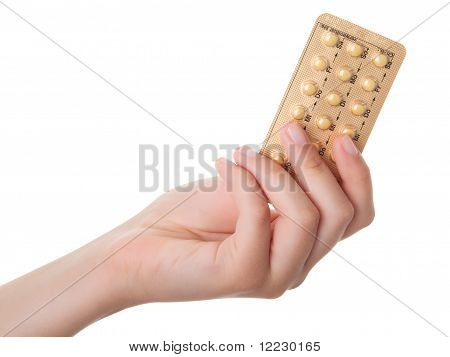 Tablets (birth Control Pills) In The Hand