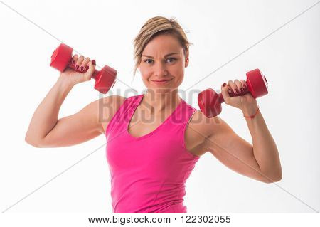Women's sports. Strong girl in the gym. Girl doing exercises.