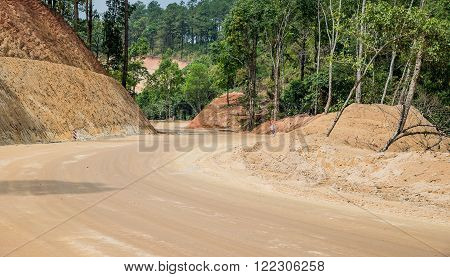 Dirt road , New road surface , Road construction path through the forest.Selective focus.