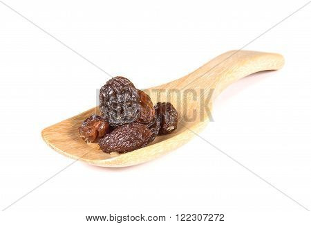 Dried grapes Raisin in wooden spoon isolated on white background.Focus raisin on spoon.