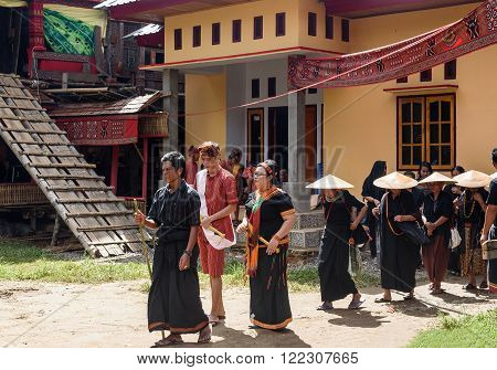 Tana Toraja, Indonesia - Dec 10, 2015:  Unidentified group of people in black at funeral ceremony. In Toraja the funeral ritual is the most elaborate and expensive even