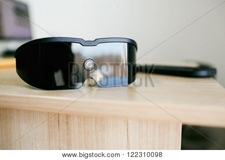 Virtual reality headset laying on office table